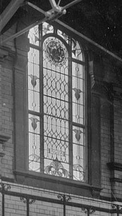 Stained glass window depicting AQUA, 1905